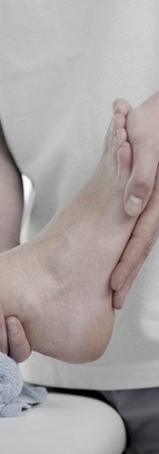 physiotherapist assessing a foot ankle joint for injury