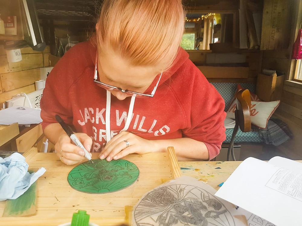 sophie painter at work in her studio linocut printmaker