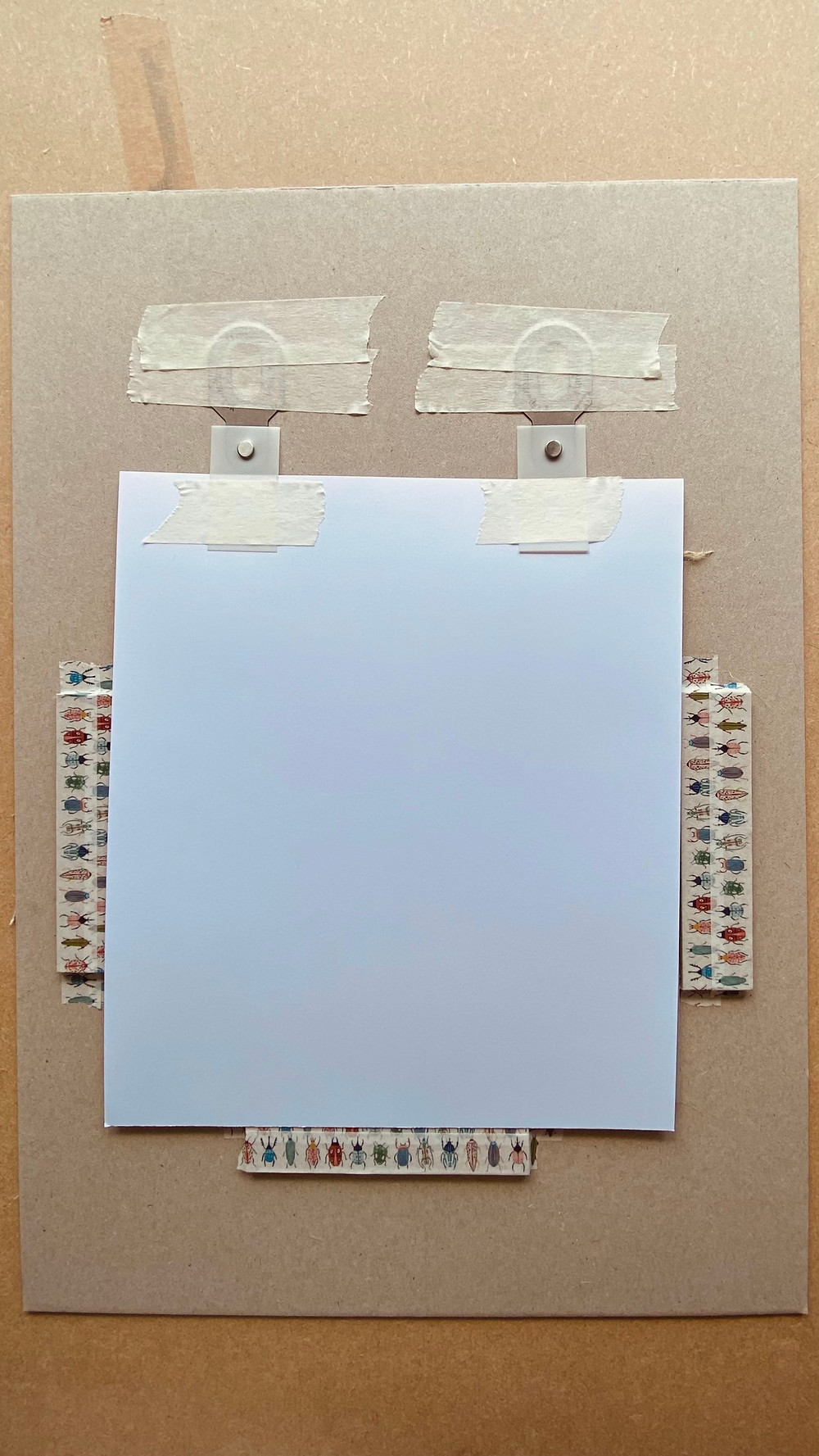 Registering paper for linocut using Ternes Burton strips and tabs