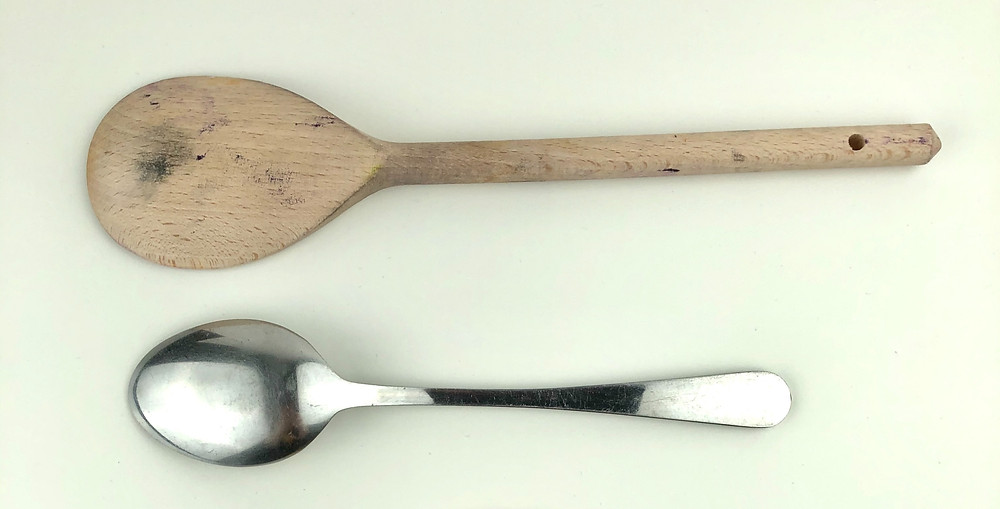 various methods for lino printing a japanese bamboo baren and a wooden spoon and a metal spoon