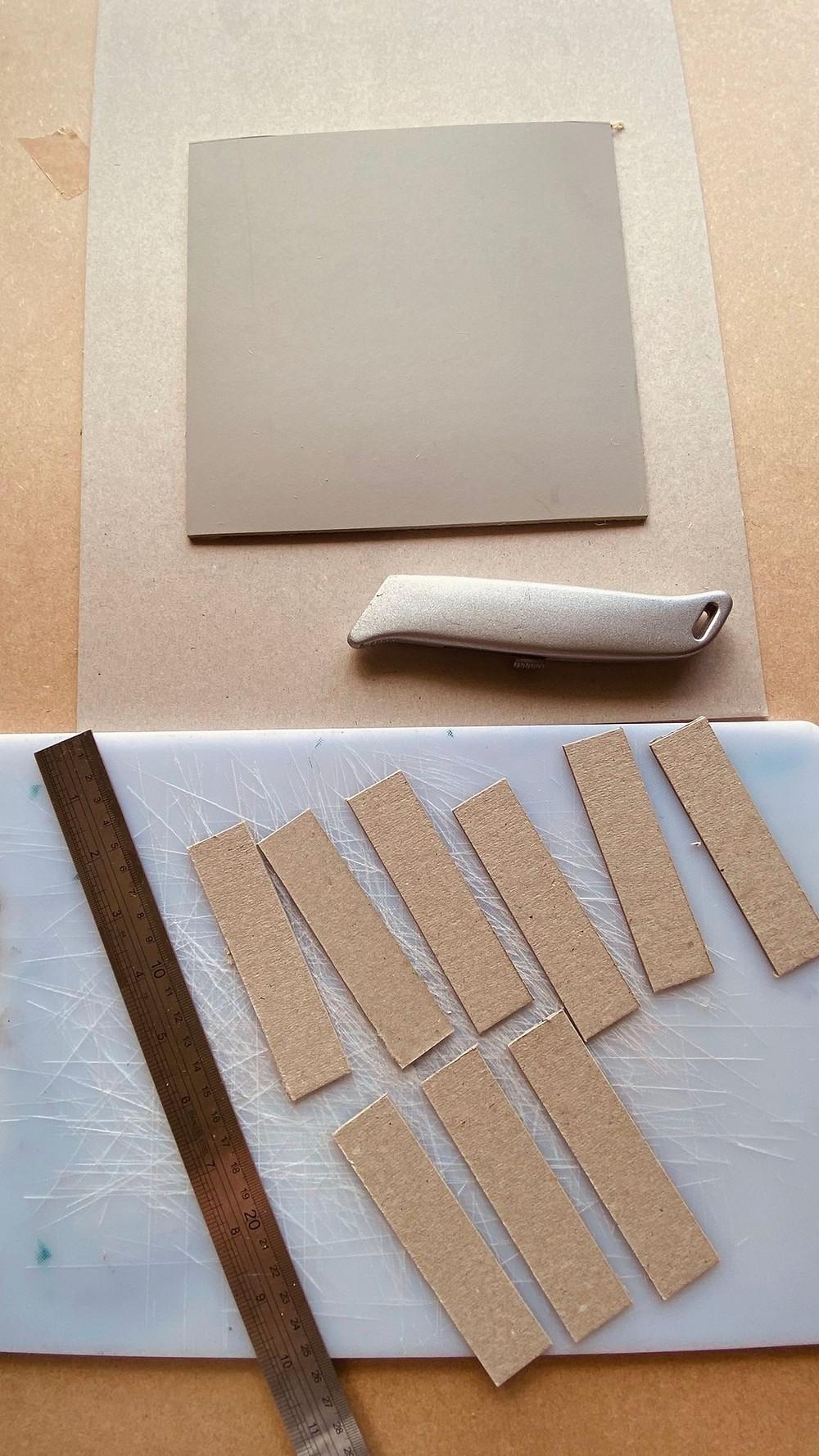 Cutting cardboard to make linocut registration board