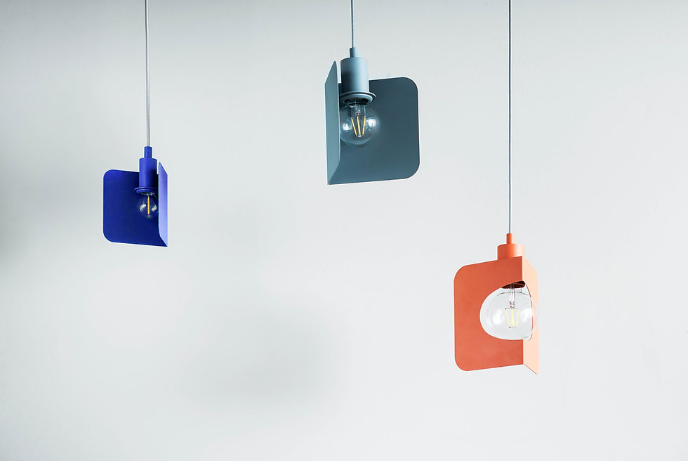 Hanging lightbulbs of different colors to symbolize bright ideas.