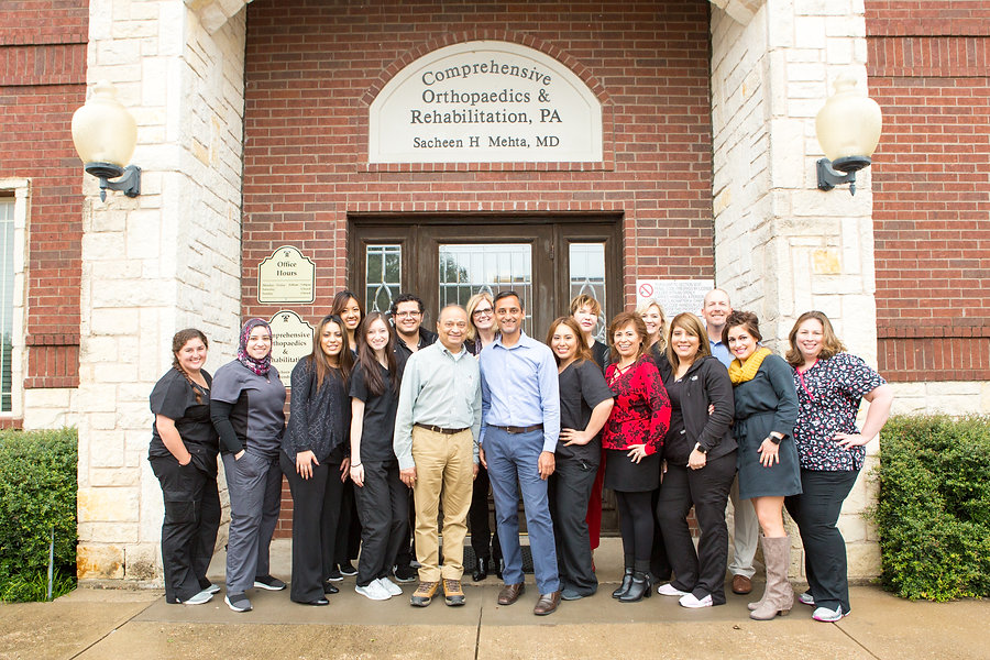 Comprehensive Orthopaedics & Rehabilitation Staff in front of our Richardson, Texas Office