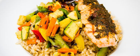 Close up of Salmon Bowl with grilled veggies and brown rice