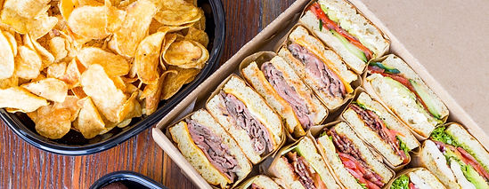 Box of Bushfire Kitchen sandwiches and large bowl of potato crisps prepared for a catering order