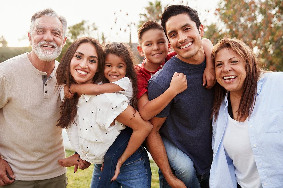Three generation Hispanic family standin