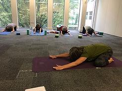 ladies practicing yoga