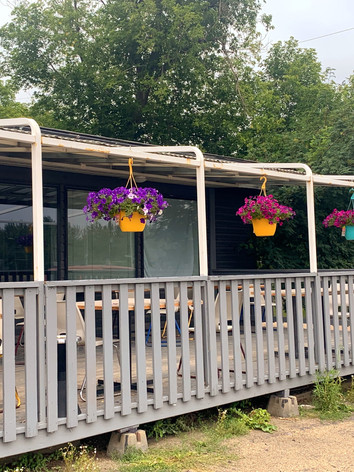 Flower baskets on our front porch