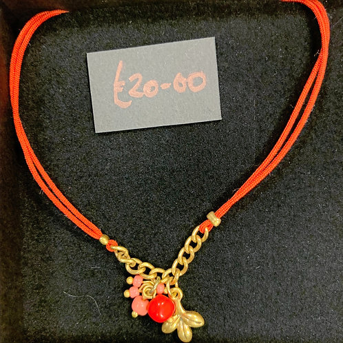 Red lace and gold bracelet