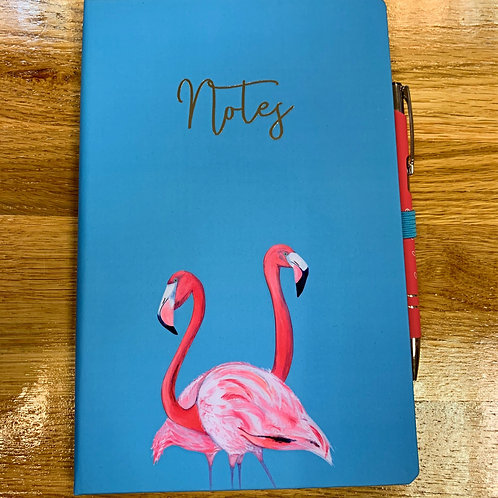Blue Notebook with pink flamingos and pen