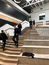School move crew on stairs