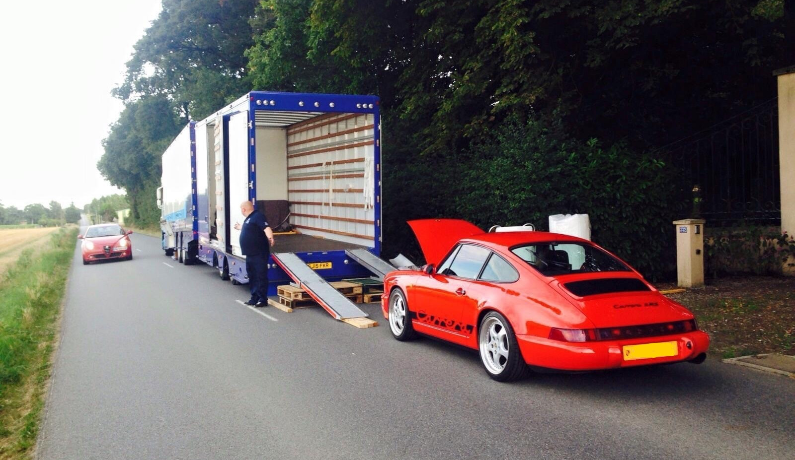 Porsche Richard Healey vehicle relocation unload