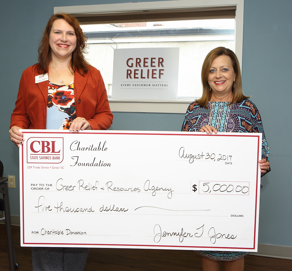 CBL Vice President Rhonda Turner (right) presents a check to Greer Relief & Resources Agency Executive Director Caroline T. Robertson.