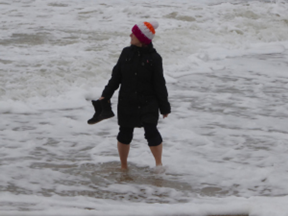 Anne paddling in the sea in Dorset on New Year's Day