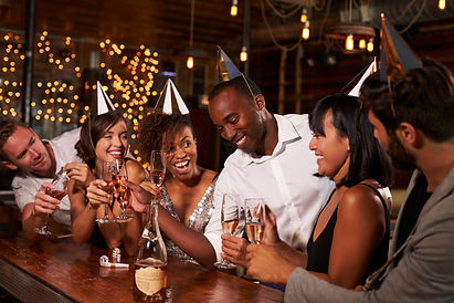 friends-in-party-hats-celebrating-new-ye