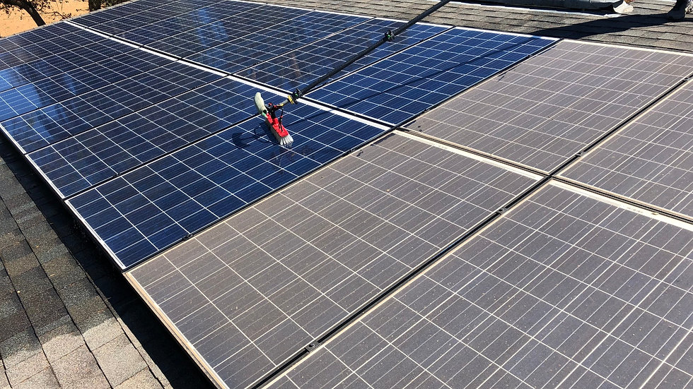 dirty solar panels being cleaned