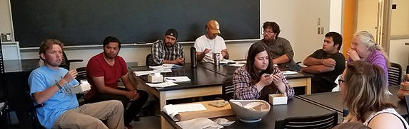 Students discuss ceramic sherds