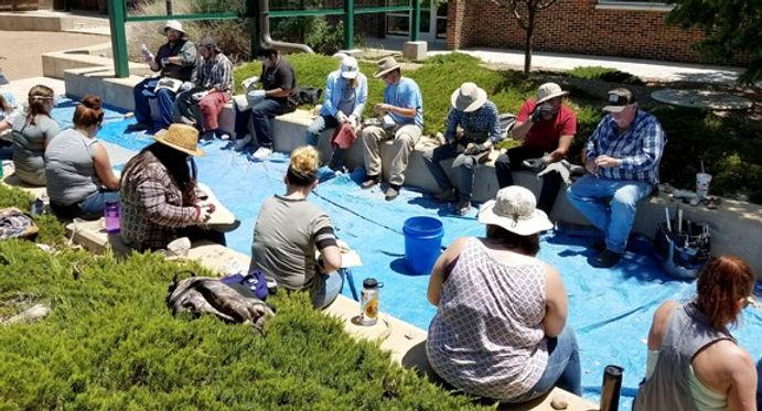 Students learn how to flintknap