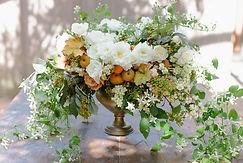 flower centerpiece with kumquats