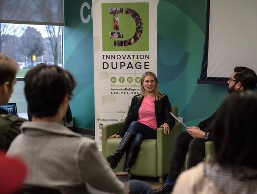 """Picture of Maureen doing a """"Fireside Chat"""" about Innovation and Entrepreneurship."""