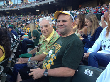 Autism Advocate Ed Schwallie with son Michael at an A's baseball game.