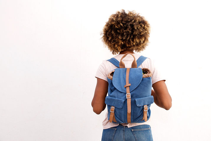 Rear view of african female student with