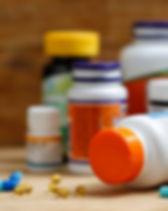 medicine-bottles-tablets-wooden-desk_138