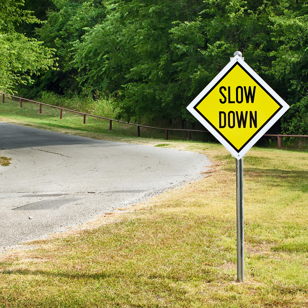 slow-down sign on road