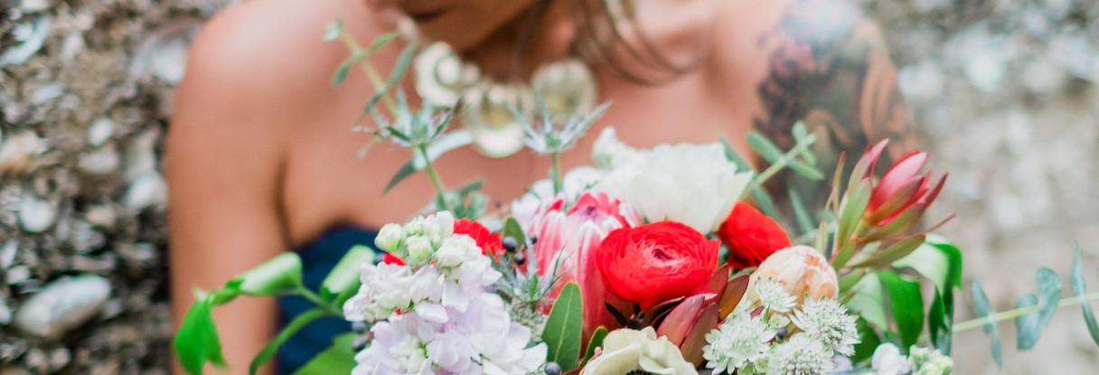 Navy bridesmaids dress and bouquet
