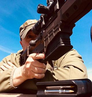 Photo of Man Aiming Gun