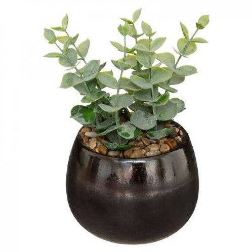 Pianta artificiale con vaso