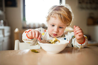 a-toddler-boy-eating-at-home-PANMH57.jpg