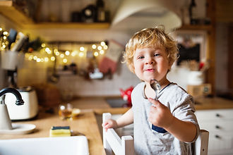 a-toddler-boy-washing-up-the-dishes-PHGA
