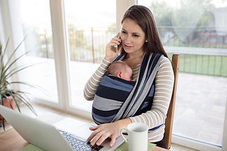 mother-with-son-in-sling-with-notebook-a