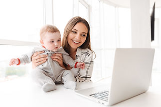 young-woman-mother-using-laptop-computer