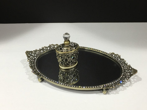 Decorative jewelry tray and perfume bottleume