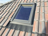 velux window installed in a concrete tiled roof. Carried out by G M Robinson Roofing Bristol