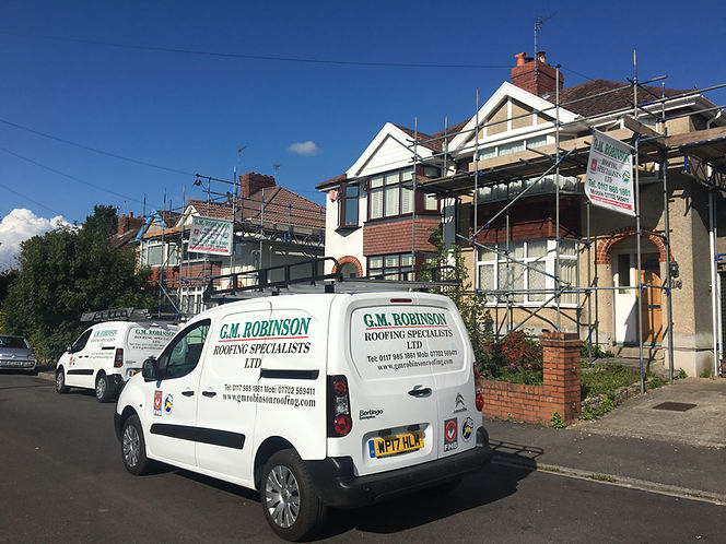 G M Robinson Roofing Specilaists Ltd Bristol with vans and new roofs