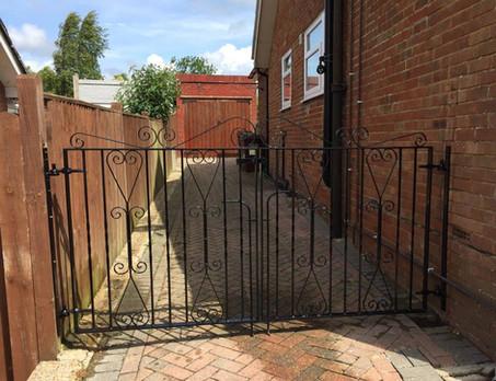 Personal access driveway metal gates