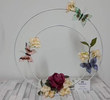 Double hoop table centrepiece with butterflies