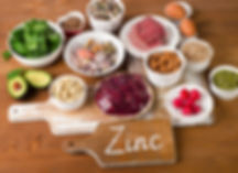 Foods with Zinc mineral on a wooden tabl
