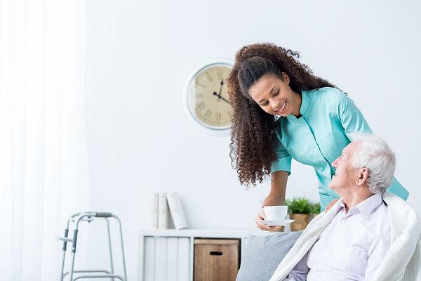 Female-caregiver-serving-afternoon-tea-t