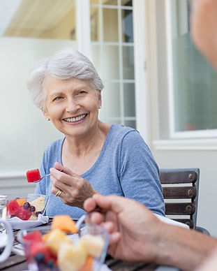 Senior-couple-having-breakfast-103020870