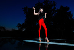 red pants louboutins pool artistic photography
