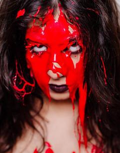 Singer Farrah Mechael Covered In Red Paint for Album Promotional Shoot