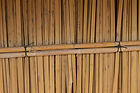 Detail of reed wall construction Station village Malawi. Vertical reeds are tied to two horizontal reeds using tire straps, malawi architecture