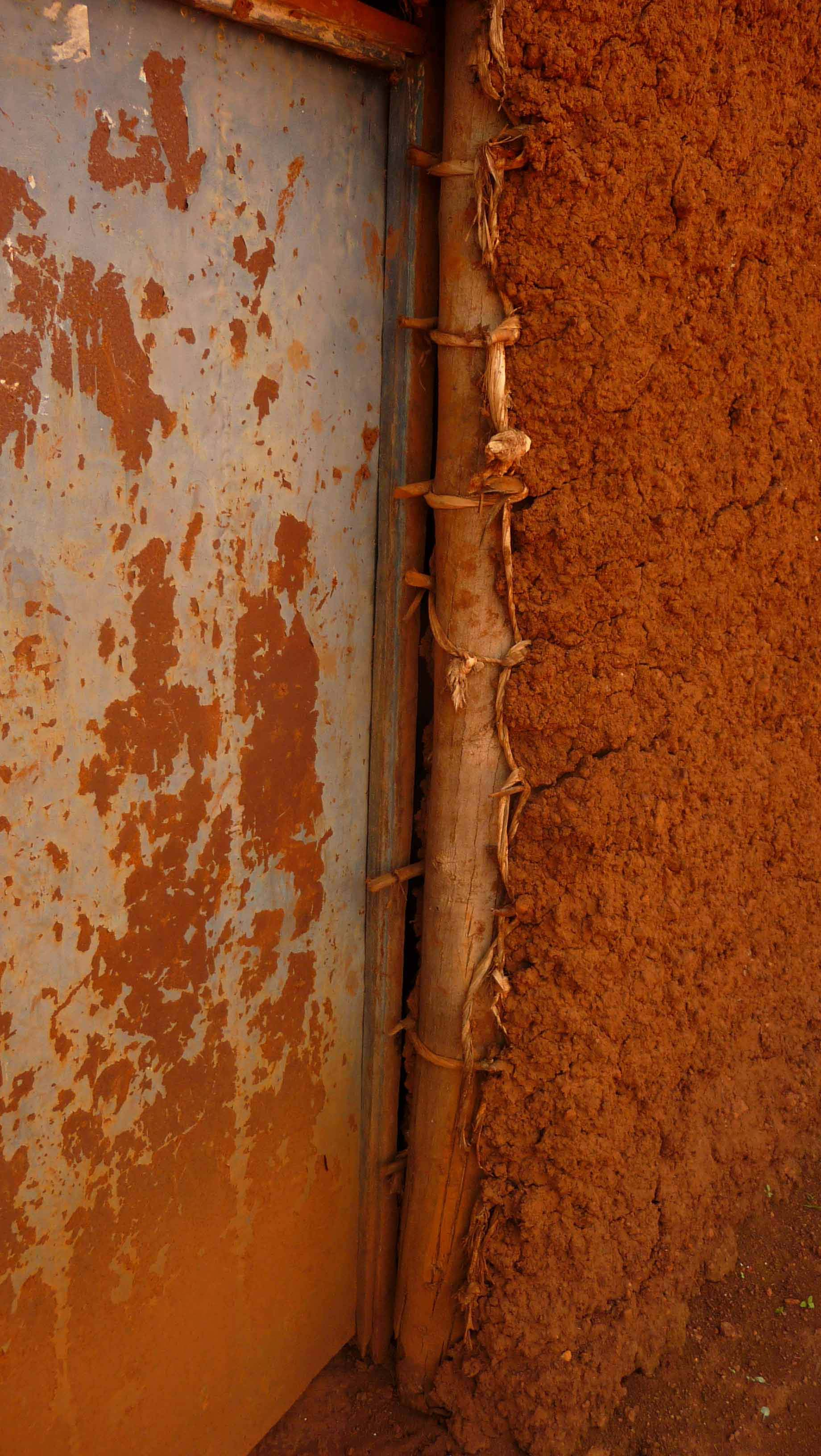 Rwanda detail of the door opening in a typical wattle & daub structure in rural