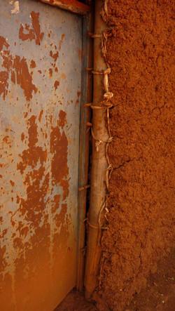 Rwanda detail of the door opening in a typical wattle & daub structure in rural