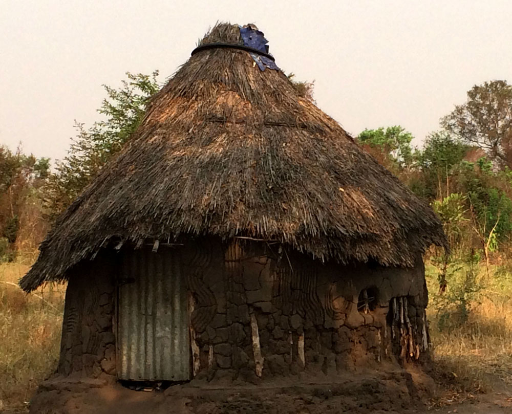 Ethiopia circular home constructed of mud on a wood pole frame (submitted by Abb