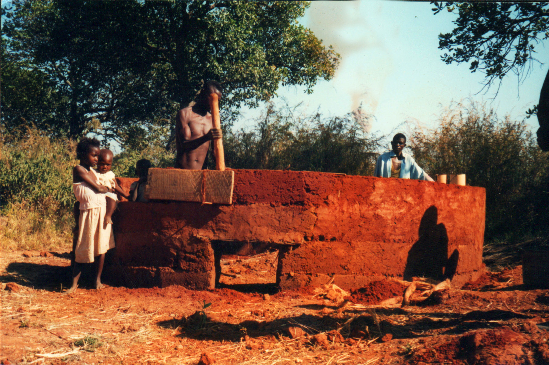 Zambia structure being constructed with rammed earth.jpg